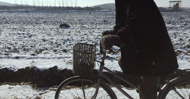 On frozen fields, North Korean farmers prep for battle ahead