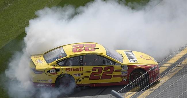 Logano takes advantage of late crash, wins Clash at Daytona