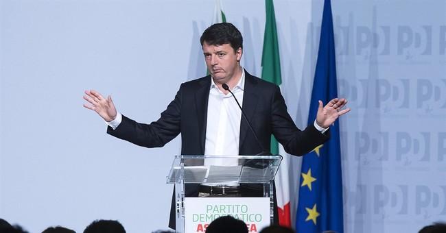 Italy's Renzi resigns as party chief, seeks renewed mandate