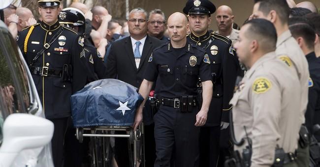 The Latest: Crowd holds vigil for slain Whittier officer