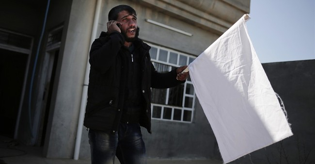 Iraqi Shiite militias push to take villages west of Mosul
