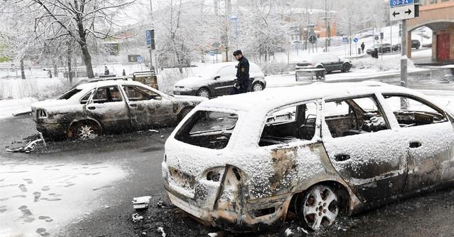 Riot in Stockholm suburb after drug suspect is arrested