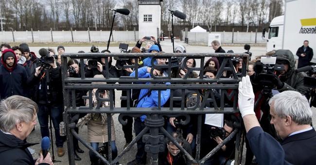 'Arbeit macht frei': Stolen Nazi gate is returned to Dachau