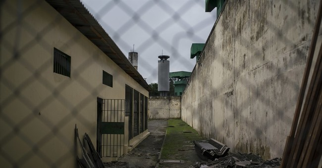Mass slaughter in Brazil prison exposes gang war over drugs