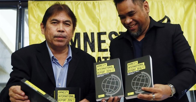 Amnesty blames Trump, others in global rollback of rights.