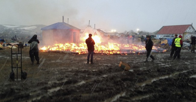 The Latest: Police: About 20 fires set at Dakota Access camp