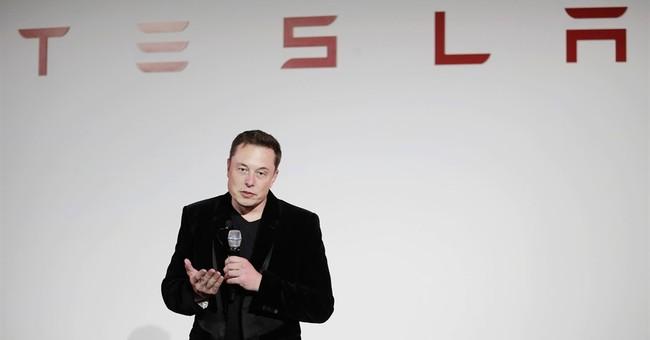 Tesla swings to loss in 4Q, says Model 3 on target