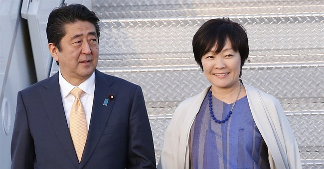 Japan first lady resigns from honorary position at school