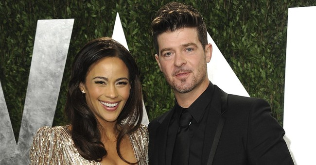 Robin Thicke's ex-wife accuses him of evidence tampering