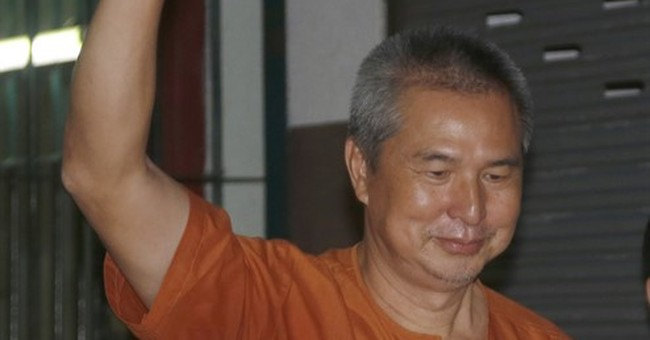 Thai editor has lese majeste jail sentence reduced
