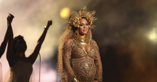 APNewsBreak: Beyonce out of Coachella; will perform in 2018