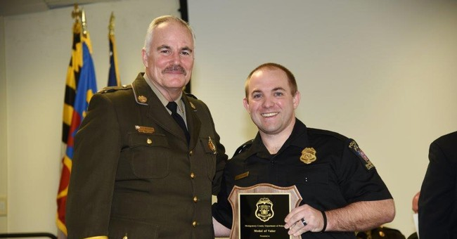 Police officer honored for heroism after apartment explosion