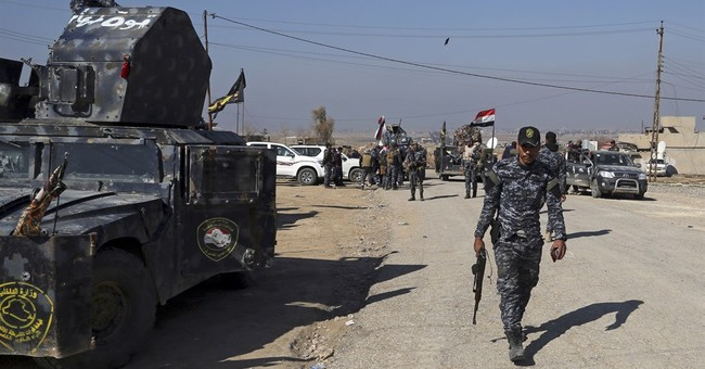 The Latest: Iraqi forces take control of IS 'sniper' village