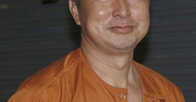 Thai editor has lese majeste jail sentence reduced