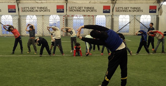 In Lebanon gyms, playtime and escape for Syrian children