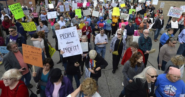 Mitch McConnell interrupted as Trump protests continue