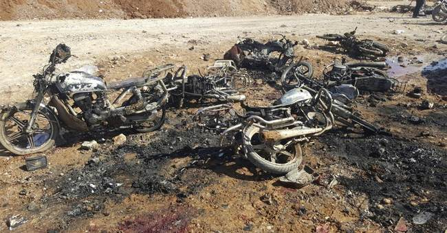 Attacks near Syria town captured from IS kill 60