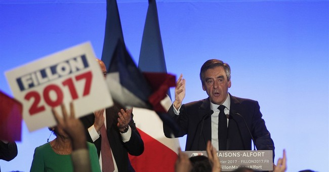 France opens full fake jobs inquiry into candidate Fillon