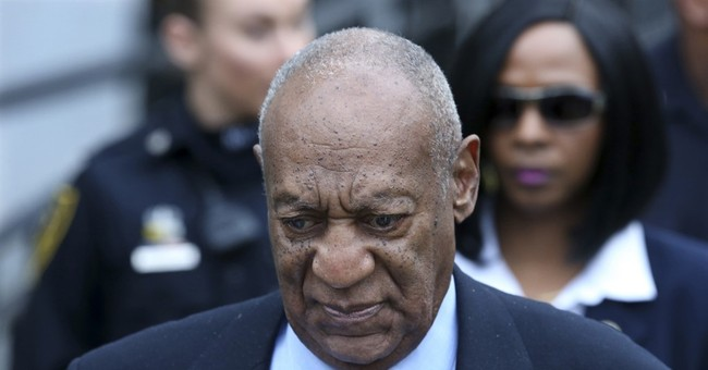 The Latest: DA says ruling lets him show Cosby's 'scheme'