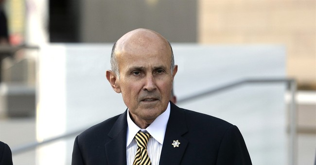 Ex-sheriff with Alzheimer's faces trial on corruption counts