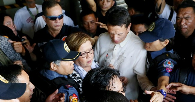 Philippine president's war of words with arrested critic