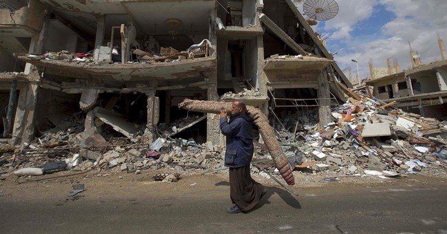 In a blow, twin attacks on Syrian security kill at least 32