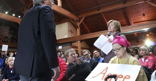 At town halls, GOP caught between Trump, angry voters