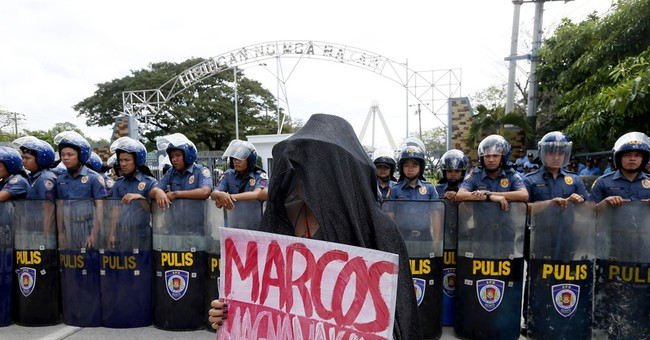 Protesters mark Philippine revolt by condemning killings