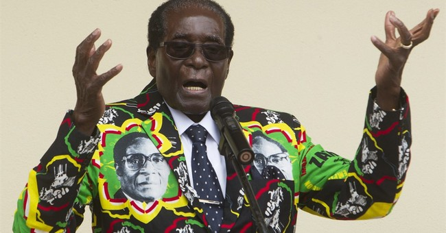 Zimbabwe's Mugabe marks 93rd birthday in opposition area