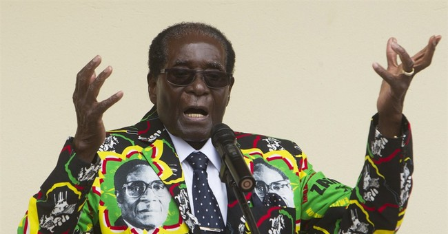 Zimbabwe's Mugabe marks 93rd birthday in opposition area