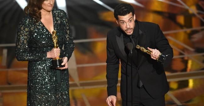 'O.J.' doc director dedicates Oscar to Brown, Goldman