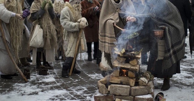 Masks and snowy streets herald pre-spring rite in Latvia