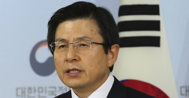 S Korea's acting leader rejects to extend probe into scandal