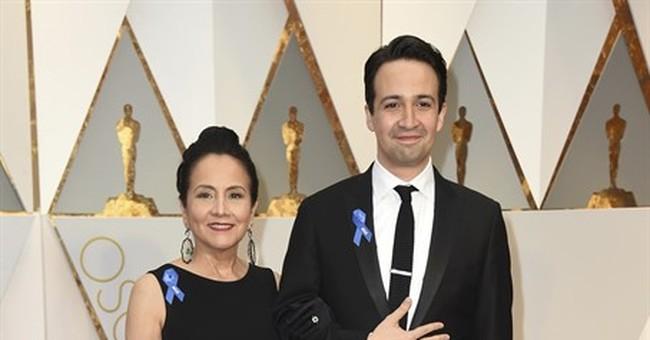 Ruth Negga in red, plenty of gold on Oscars red carpet