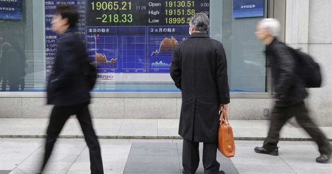 Asian markets lower as investors look to Trump speech