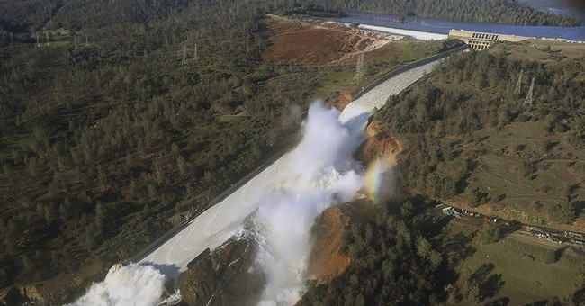 Officials to stop California dam's outflow to clear debris