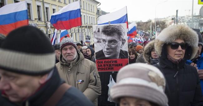 Russians march to honor slain opposition leader Nemtsov