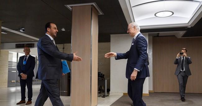 The Latest: Head of al-Qaida affiliate derides Syria talks