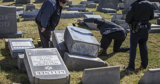 Jewish centers cope with bomb threats; graves vandalized