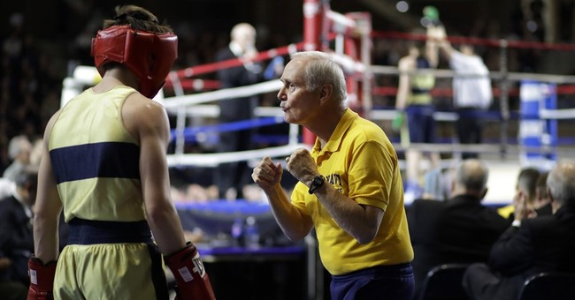 AP PHOTOS: Navy midshipmen lace up gloves, get in the ring