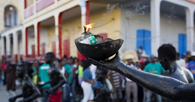 AP PHOTOS: Colorful Carnival in Haiti's storm-hit region