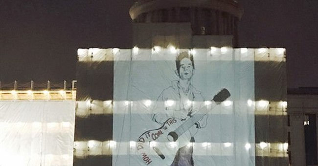 State says keep Woody Guthrie image off Oklahoma Capitol