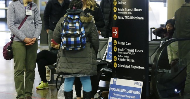 Airports, legal volunteers prepare for new Trump travel ban