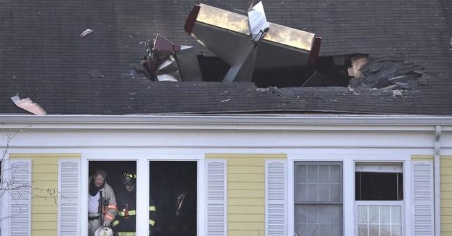 Home-built plane crashes through condo roof, killing pilot