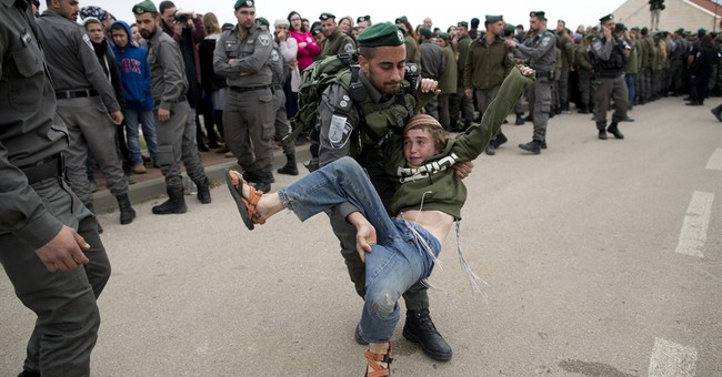 Israeli forces begin evacuating 9 settler homes in West Bank