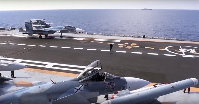 Russia says it starts Syrian drawdown with aircraft carrier