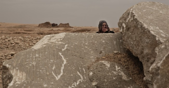 A 3,000-year-old city wrecked by militants, left for looters