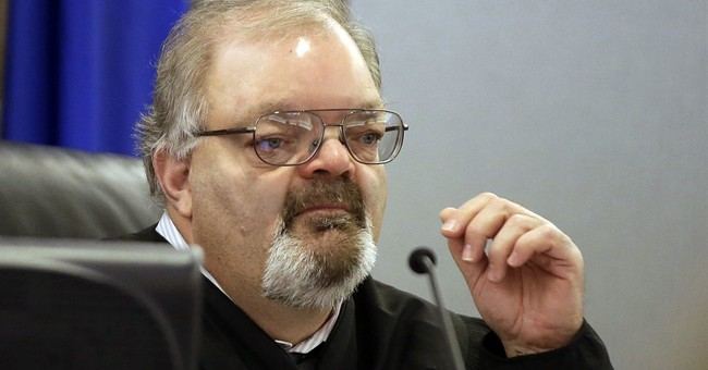 Ex-judge banned from Nevada bench for handcuffing of lawyer