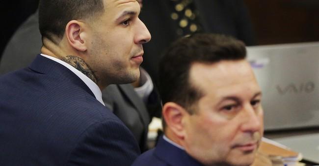 The Latest:  DA says ex-NFL star killed 2 over spilled drink