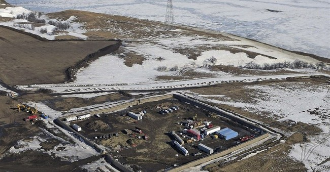 The Latest: Flood risk greatly reduced in protest camp area